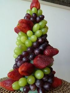 fruit pyramid/castle with grapes and strawberries